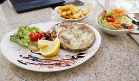 Swordfish steak served in the reastaurant Royalty Free Stock Photography
