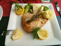 Swordfish steak with vegetables Stock Photos