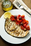 Swordfish with tomatoes Royalty Free Stock Photo