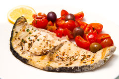 Swordfish with tomatoes royalty free stock photography