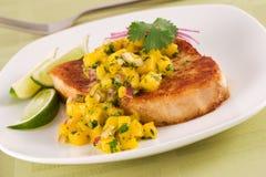 Swordfish with tropical salsa stock photography