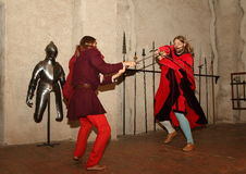 Swording Fighters. Portrait of battling fighters in swords as a summer 2015 performance in Svihov Water Castle, Western Bohemia, Czech Republic Stock Image