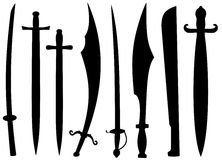 Swords. Isolated silhouettes of swords on a white background Royalty Free Stock Images
