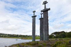 Swords in Rock. Three large swords stand on the hill as a memory to the Battle of Hafrsfjord in year 872, when King Harald Fairhair gathered all of Norway under Royalty Free Stock Photos