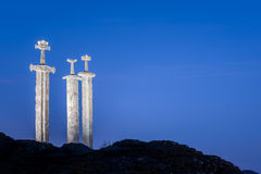 Swords in Rock in Stavanger. The sculpture of Swords in Rock Sverd i fjell in the Hafrsfjord near Stavanger in Rogaland county, Norway Stock Image
