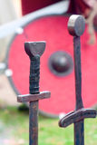 Swords and shield. Two old swords and a shield on grass Royalty Free Stock Image