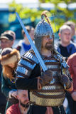 Swordsman in armor. ST. PETERSBURG, RUSSIA - MAY 27, 2017: Swordsman in armor at the festival `Legends of the Norwegian Vikings` on City Day Stock Photo