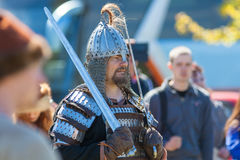Swordsman in armor. ST. PETERSBURG, RUSSIA - MAY 27, 2017: Swordsman in armor at the festival `Legends of the Norwegian Vikings` on City Day, circa 2017 Stock Image
