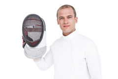 Swordsman holding fencing mask. Portrait of swordsman holding fencing mask on white background Royalty Free Stock Photos