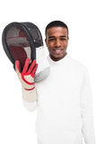 Swordsman holding fencing mask. Portrait of swordsman holding fencing mask on white background Royalty Free Stock Photo