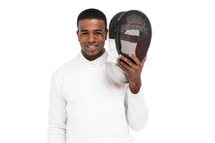 Swordsman holding fencing mask. Portrait of swordsman holding fencing mask on white background Royalty Free Stock Photography