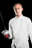 Swordsman holding fencing sword Stock Photos