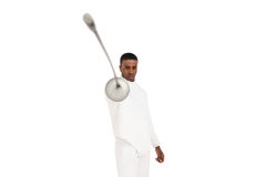Swordsman practicing with fencing sword. Portrait of swordsman practicing with fencing sword on white background Stock Photo