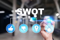 Swot analysis concept on the virtual screen. Swot analysis concept - a study by an organization to identify its internal strengths, weaknesses, as well as its stock photo