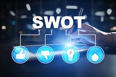 Swot analysis concept on virtual screen. Swot analysis concept  - a study by an organization to identify its internal strengths, weaknesses, as well as its stock photography