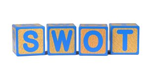 SWOT on Colored Wooden Childrens Alphabet Block. Stock Photography