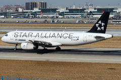 SX-DVQ Aegean Airlines, Airbus A320-232. SX-DVQ with Star Alliance livery is rolling for take-off on runway 35L at Istanbul Ataturk Airport LTBA, August 7 , 2015 royalty free stock images