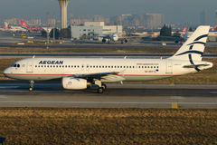 SX-DVY Aegean Airlines, Airbus A320-232. SX-DVY is rolling for take-off on runway 35L of Istanbul Ataturk Airport LTBA, December 27 , 2015 stock images