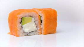 Syake fila maki roll raw salmon with cream cheese and avokado on white stock video footage