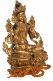 The Syama Tara Green Tara statuette with amber beads. Isolated on the white background royalty free stock photography