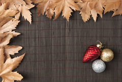 Sycamore leaves and christmas ornaments Royalty Free Stock Image
