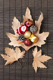 Sycamore leaves and christmas ornaments Stock Photo