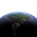 Sydamerika på natten på realistisk modell av jord Royaltyfria Bilder