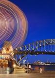 Sydne Luna Ferry Wheel Arc Vert sunset. Australia Sydney City Harbour bridge and other landmarks at sunset illuminated with lights and blurred motion of Royalty Free Stock Photography