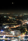 Sydney from above at night. Aerial view of Sydney city from above / a skyscraper. There is a moon hovering above the sparkling city below Royalty Free Stock Photos