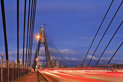 Sydney Anzac bridge Ropes sunset. Australia sydney city CBD ANZAC bridge cables and masts at sunset with driving cars in heavy traffic with illuminated blurred stock photography