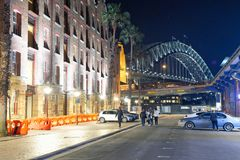 SYDNEY - AUGUST 17, 2018: Night view of The Rocks and Sydney Harbor Bridge. This district is a meeting point for young people royalty free stock photography