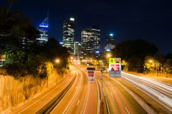 Night photography of Toll Road with Cityscape at the background. Stock Photography