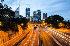 Night photography of Toll Road with Cityscape at the background. Royalty Free Stock Image