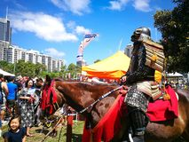 Samurai Armour cosplay on the horse.The image at Matsuri Japanese Festival. stock photo
