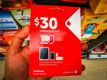 Vodafone sim card 30 dollar prepaid starter pack works in all phones, tablets and modems. SYDNEY, AUSTRALIA. – On February 18, 2018. - Vodafone sim card royalty free stock photo