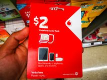 Vodafone sim card 2 dollar prepaid starter pack works in all phones, tablets and modems. SYDNEY, AUSTRALIA. – On February 18, 2018. - Vodafone sim card 2 royalty free stock images
