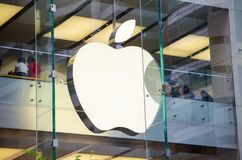 Apple Store logo at glass window in close up. SYDNEY, AUSTRALIA – On January 26, 2018. – Apple Store logo at glass window in close up Stock Images