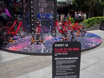 """Fly me to the moon , peddling on """"flying bike"""" sculpture Lunar Velocipede created by arts company Erth Visual stock images"""