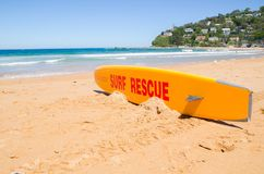 Orange surf rescue board of life guard on the sand at Palm beach, NSW. stock image
