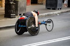 Wheelchair road racing game competition at the rocks on Australia day. SYDNEY, AUSTRALIA – On January 26, 2018. – Wheelchair road racing game stock photos