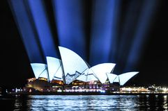An annual outdoor lighting festival with immersive light installations and projections `Vivid Sydney` the image at Opera house. SYDNEY, AUSTRALIA. – On stock images