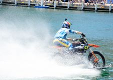 WaterBike ride by Robbie Maddison Australian stunt rider, the image shows how to ride his dirt bike on water in action. A SYDNEY, AUSTRALIA. – On royalty free stock image