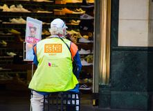 A man vendor selling ` The big Issue ` newspaper at Pitt St., Sydney downtown. SYDNEY, AUSTRALIA. – On November 11, 2017. - A man vendor selling ` The royalty free stock image