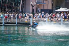 WaterBike ride by Robbie Maddison Australian stunt rider, the image shows how to ride his dirt bike on water in action. A SYDNEY, AUSTRALIA. – On November 25 Stock Photo
