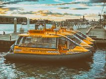 SYDNEY, AUSTRALIA - AUGUST 19, 2018: Water taxis docked in Darling arbour. They are a common way to move across the city.  royalty free stock photo