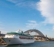 Ocean liner, cruise liner, ship with Sydney Harbour bridge on the background. Sydney, Australia - December 2, 2008: Ocean liner, cruise liner, ship with Sydney Royalty Free Stock Image