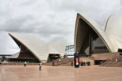 Sydney, Australia. FEBRUARY 14, 2008: People walk outside the Opera House in . The Sydney Opera House is a UNESCO World Heritage Site since 2007 royalty free stock images