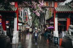 Sydney, Australia - February 25, 2017: Woman under the Chinatown arch in Sydney, Australia. Tourist posing under the Chinatown gate in Sydney, Australia Royalty Free Stock Images
