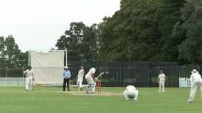 SYDNEY, AUSTRALIA - JANUARY 31, 2016: batsman plays a drive shot in a cricket game. SYDNEY, AUSTRALIA - JANUARY 31, 2016: low angle view of a batsman playing a royalty free stock photo