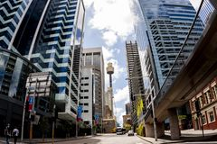 Sydney, Australia - January 12, 2009: Famous Sydney Tower Eye, known as Westfield Tower, between skyscrapers at Sydney street royalty free stock photos